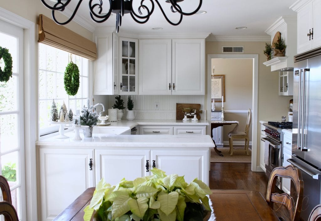 christmas kitchen tour white kitchen with greens poinsettias holiday decorating