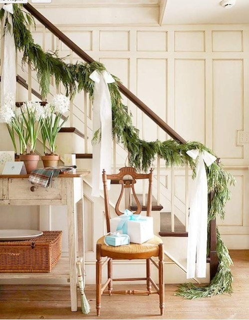 neutral christmas decor garland stairwell greens paperwhites gorgeous