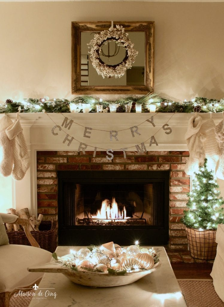 Christmas nights tour fireplace with candles, garland and stockings charming French country room