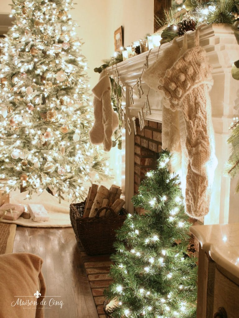 Christmas nights tour tree lit up with fireplace and stockings gorgeous holiday decor