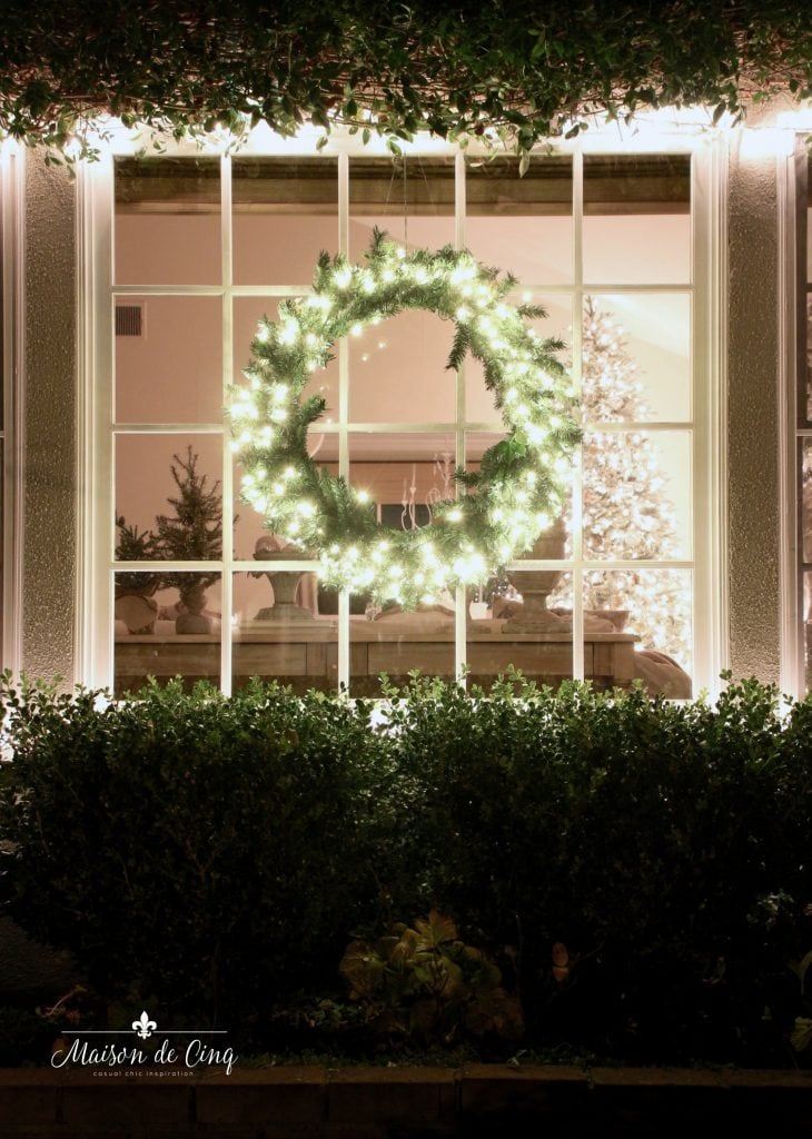 Christmas nights tour outside window with lit up wreath