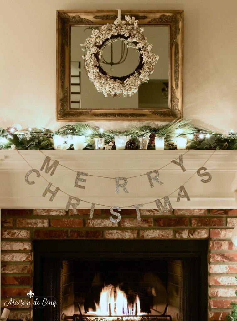 Christmas nights tour fireplace with Merry Christmas banner and wreath on mirror candles garland