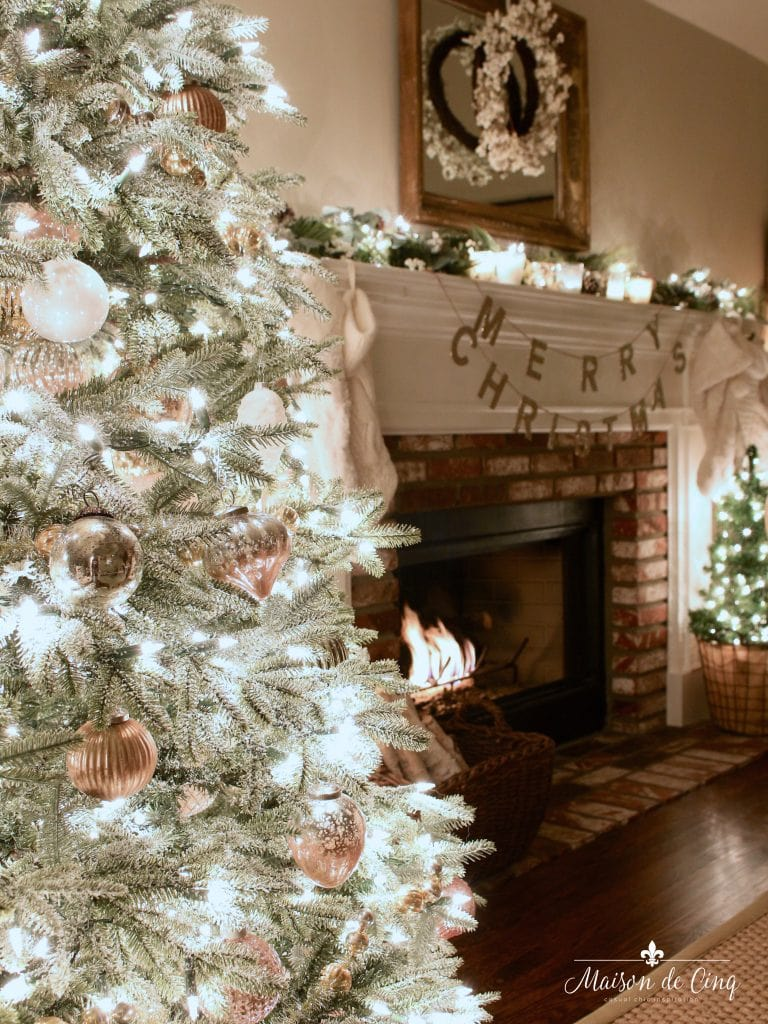 Christmas nights tour fireplace with garland, banner and candles christmas tree lit up gorgeous holiday decor