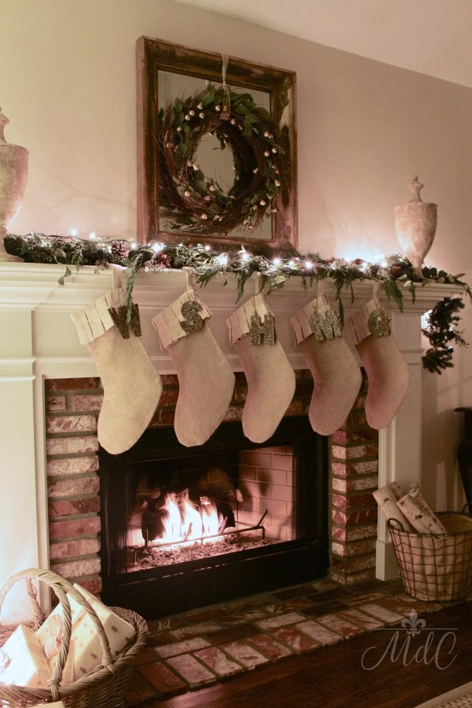 christmas nights fireplace stockings chimney wreath french country living room