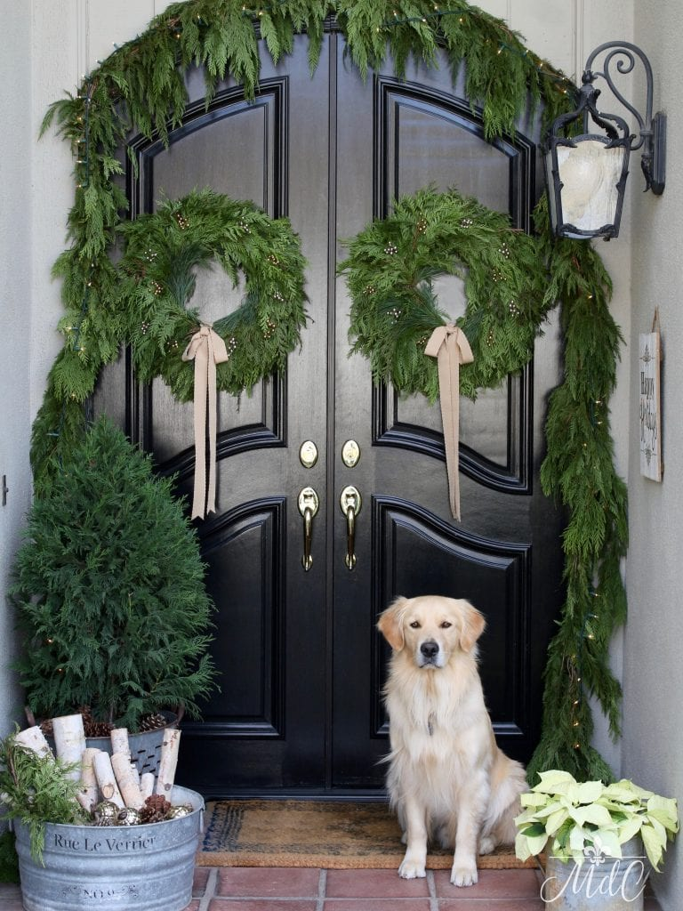 christmas front porch greens wreaths dog black front door holiday decor