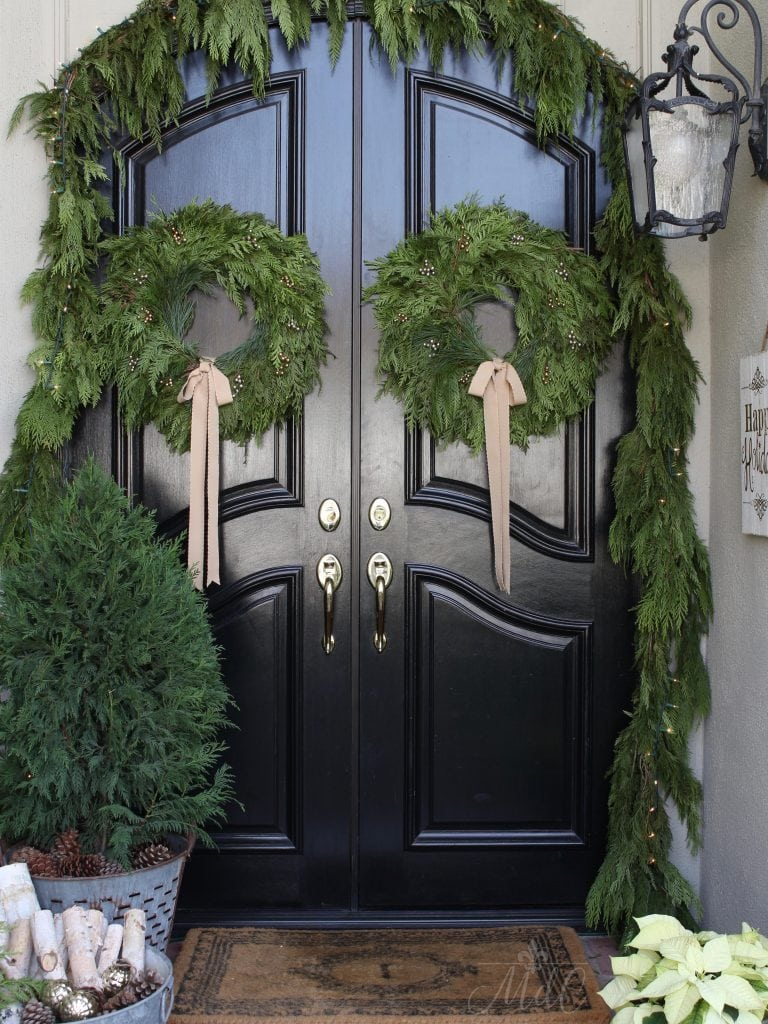 christmas front porch black doors natural garland greens cedar wreaths stunning holiday decor