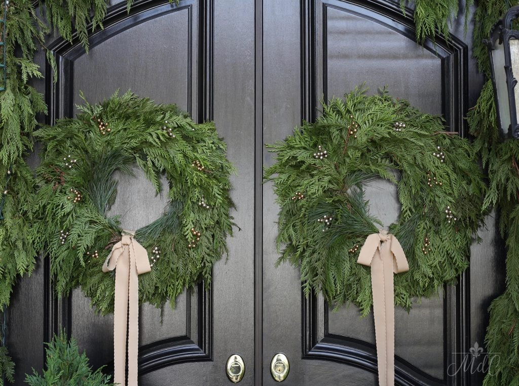 christmas front porch black doors gorgeous natural fresh wreaths greens garlands