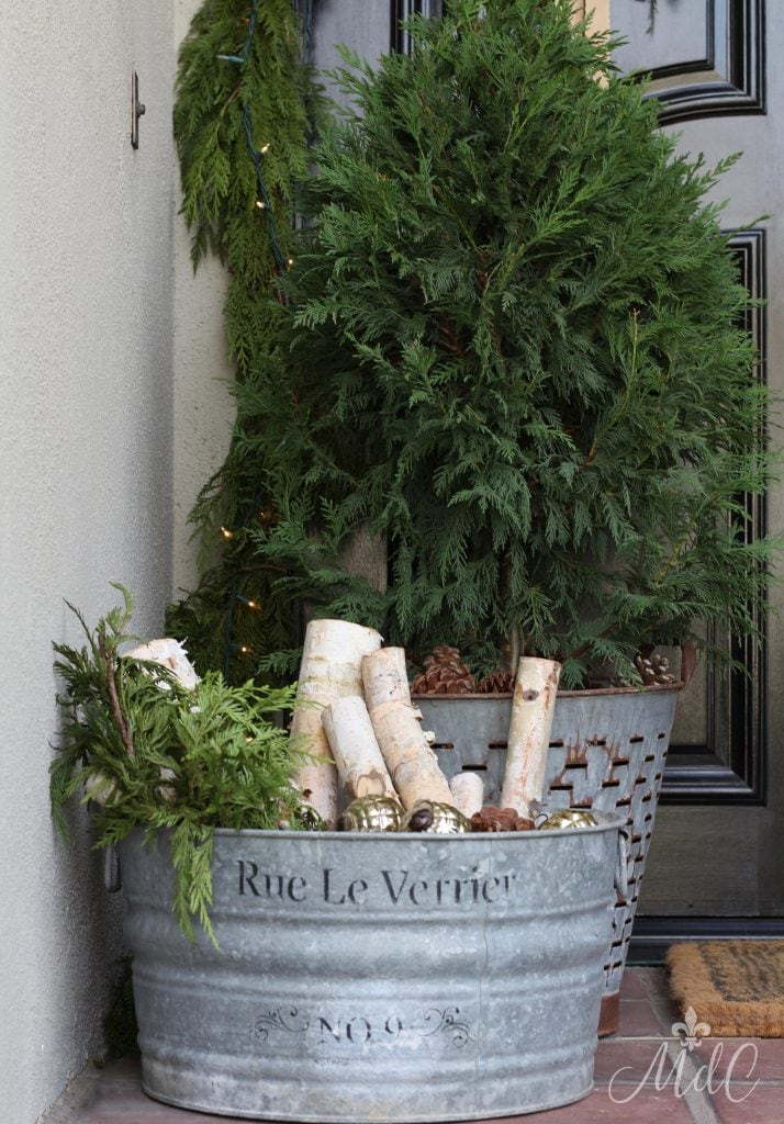 christmas front porch vintage bucket christmas tree greens