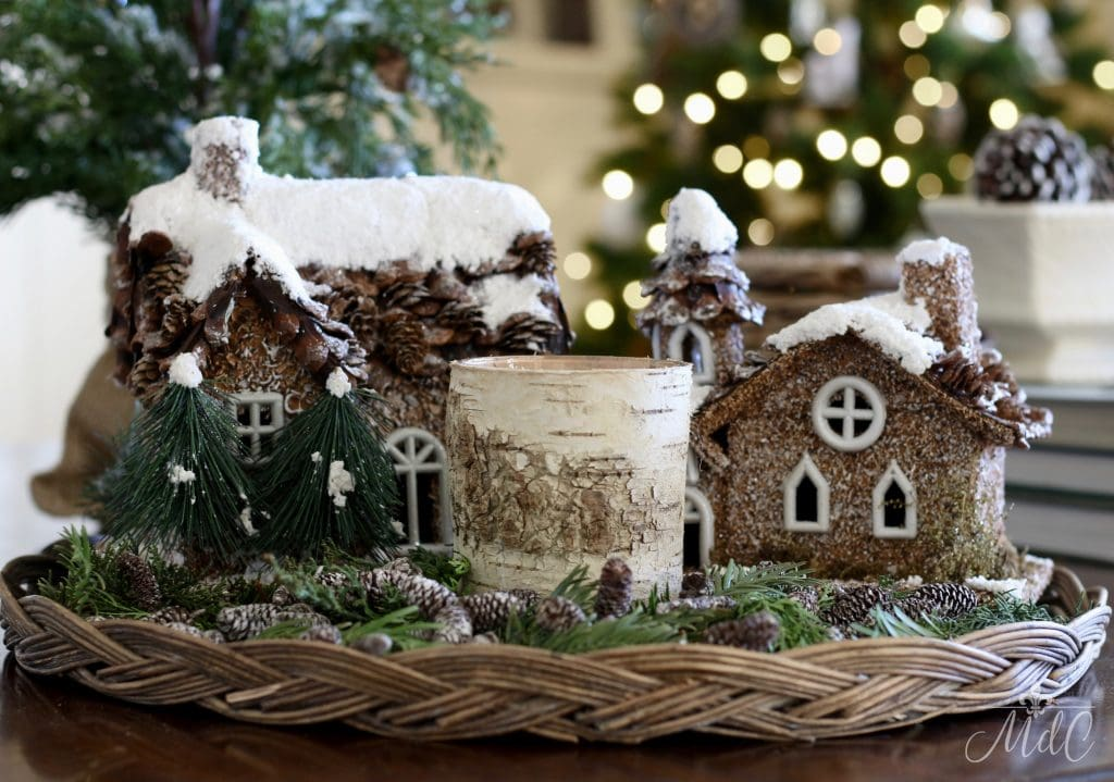 french inspired christmas little christmas houses cottages pinecones greenery