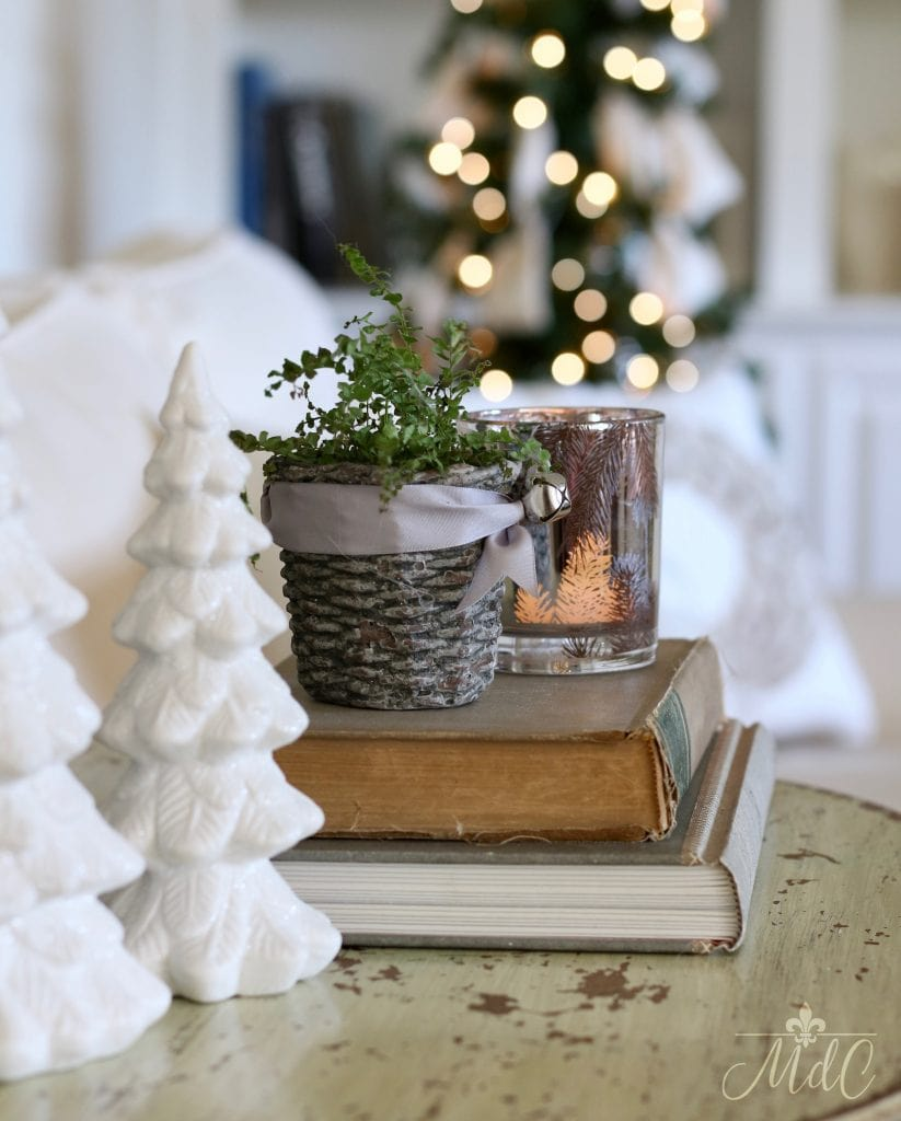 french inspired christmas table vignette trees candle books neutral decor holiday