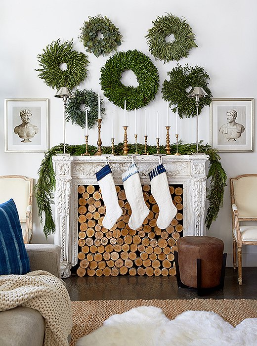 neutral christmas decor wreaths over mantel greenery holiday decorating