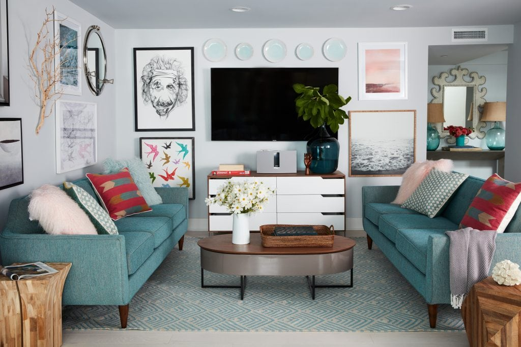 HGTV Dream Home downstairs den sitting area sofa tv gallery wall
