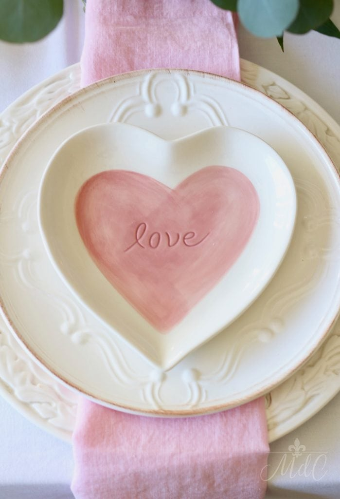 simple Valentine's Day table white plates layered pottery barn pink heart plates pink napkin