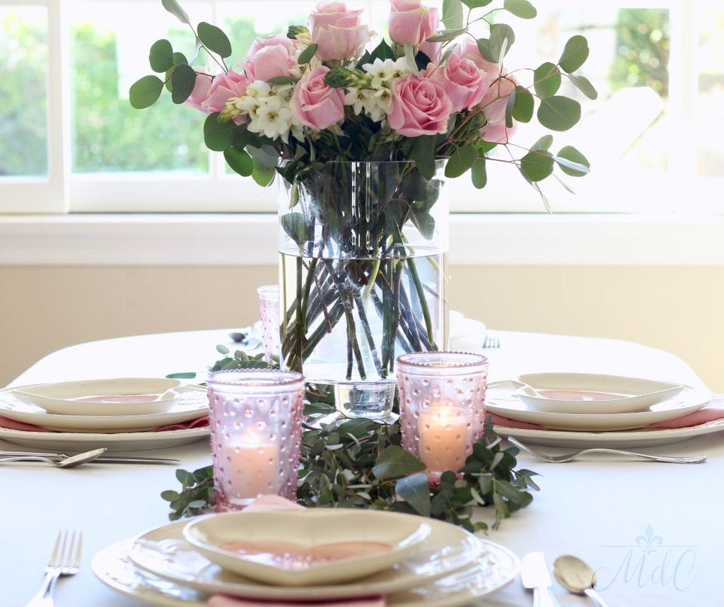 simple Valentine's Day table gorgeous floral arrangement pink roses pink hobnail candleholders pretty
