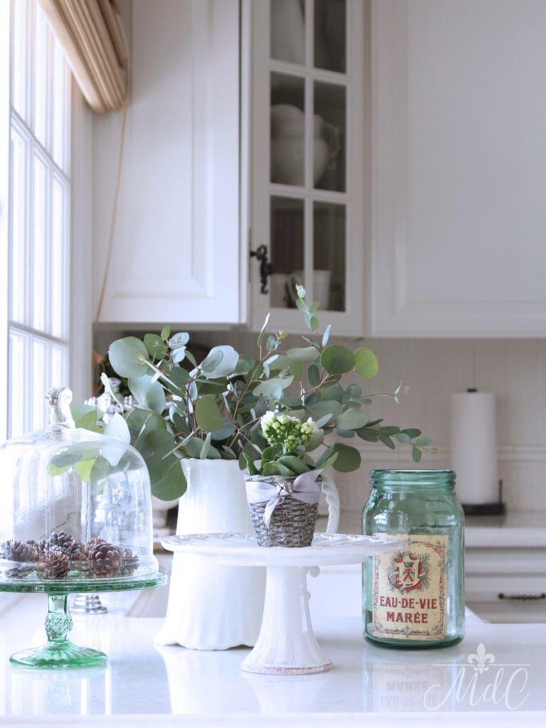 winter decorating ideas kitchen styling greens pine cones green accessories white kitchen