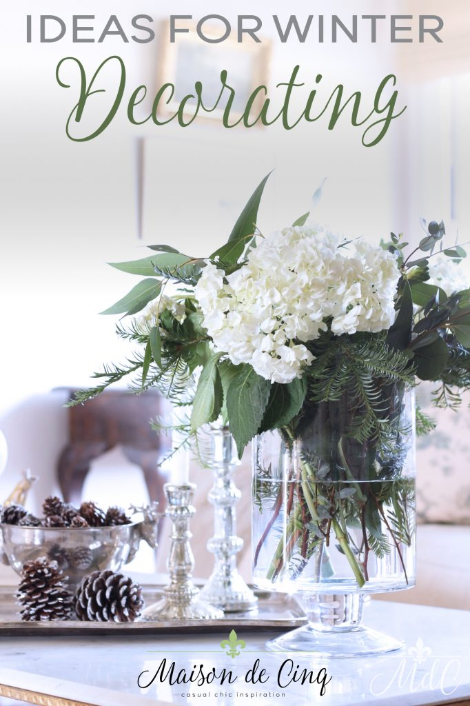 winter decorating flowers hydrangeas pine eucalyptus floral vase pine cones silver tray coffee table styling