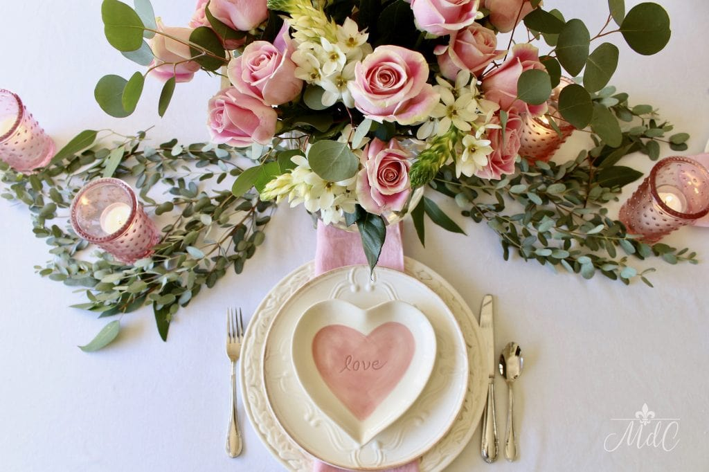 simple valentine's day table pink roses candles eucalyptus heart plates