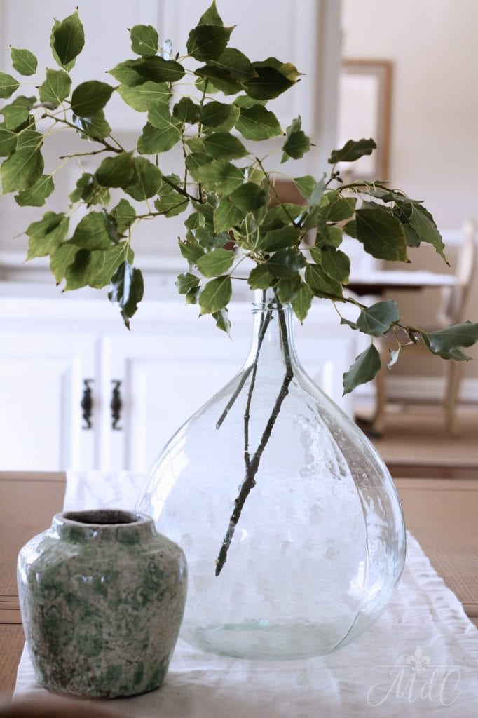 winter decorating ideas greens in demijohn winter styling