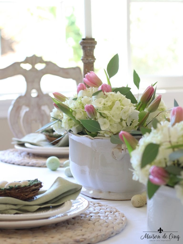 easter tablescape white hydrangeas and pink tulips centerpiece