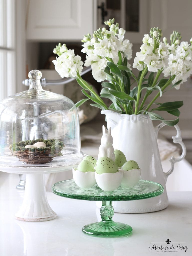 easter decor ideas pitcher white flowers green eggs cloche cake stand nest