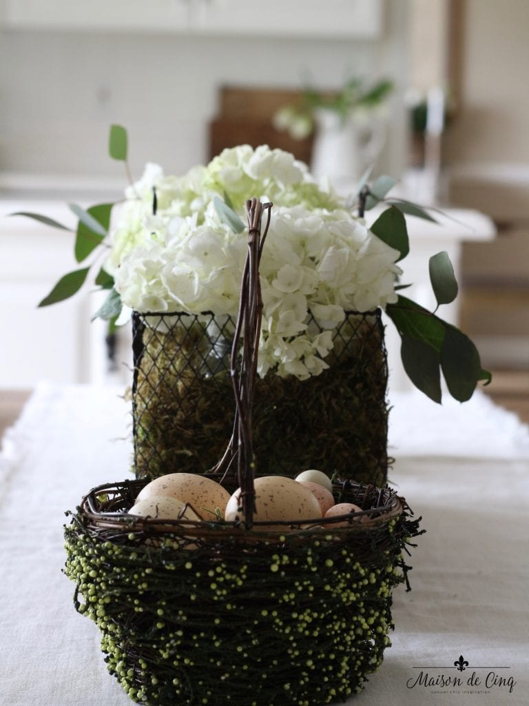 easter decor ideas white hydranges wire basket eggs spring tablescape centerpiece