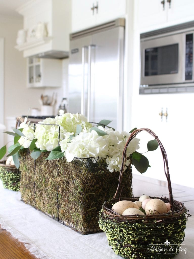 easter decor ideas table centerpiece wire basket white hydrangeas eggs white kitchen