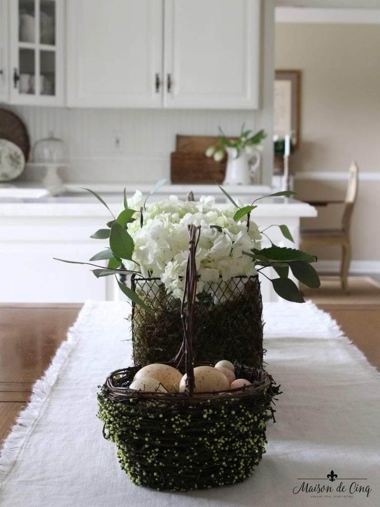 easter decor ideas table centerpiece hydrangeas baskets eggs white kitchen