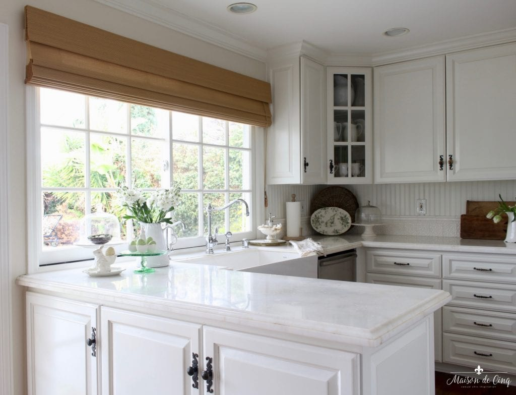 easter decor ideas white farmhouse kitchen marble counters matchstick shade windows spring decorating