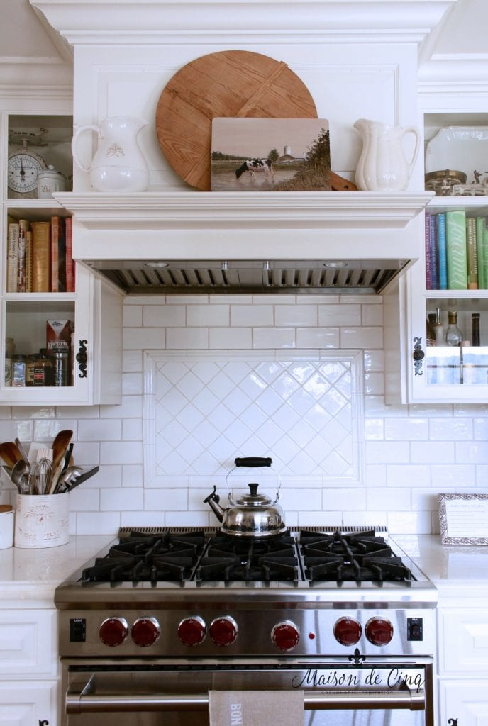 art in the kitchen stove mantel artwork bread boards ironstone pitchers subway tile backsplash