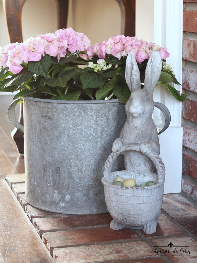 spring decorating ideas vintage bucket with hydrangeas bunny with eggs