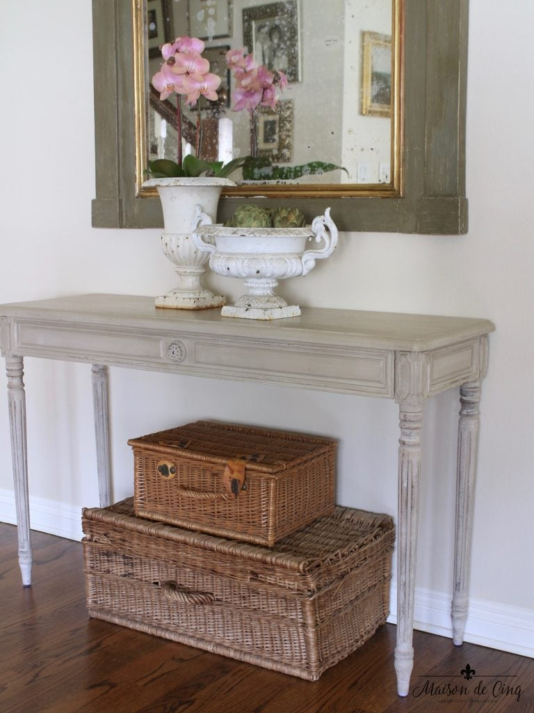 spring decorating ideas entryway orchid antique french urns baskets console table