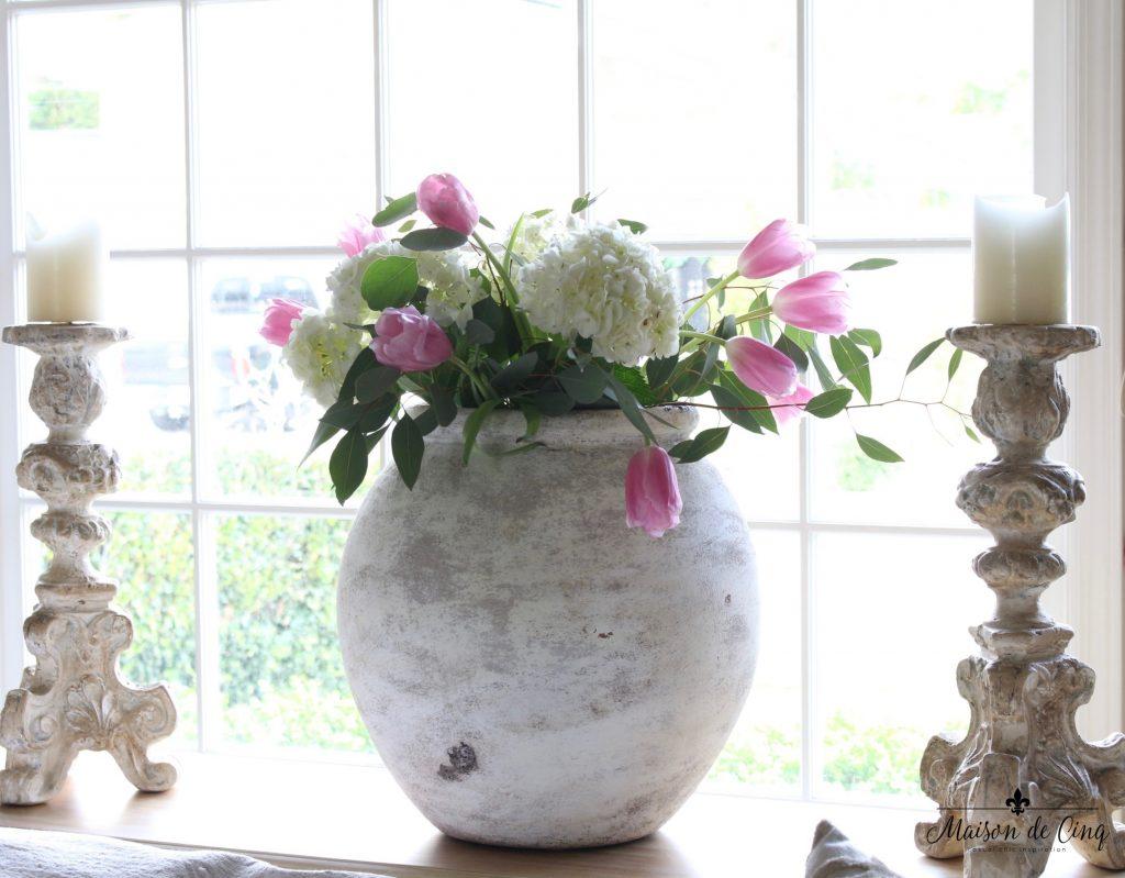 spring decorating ideas large urn white hydrangeas pink tulips candlesticks gorgeous decor