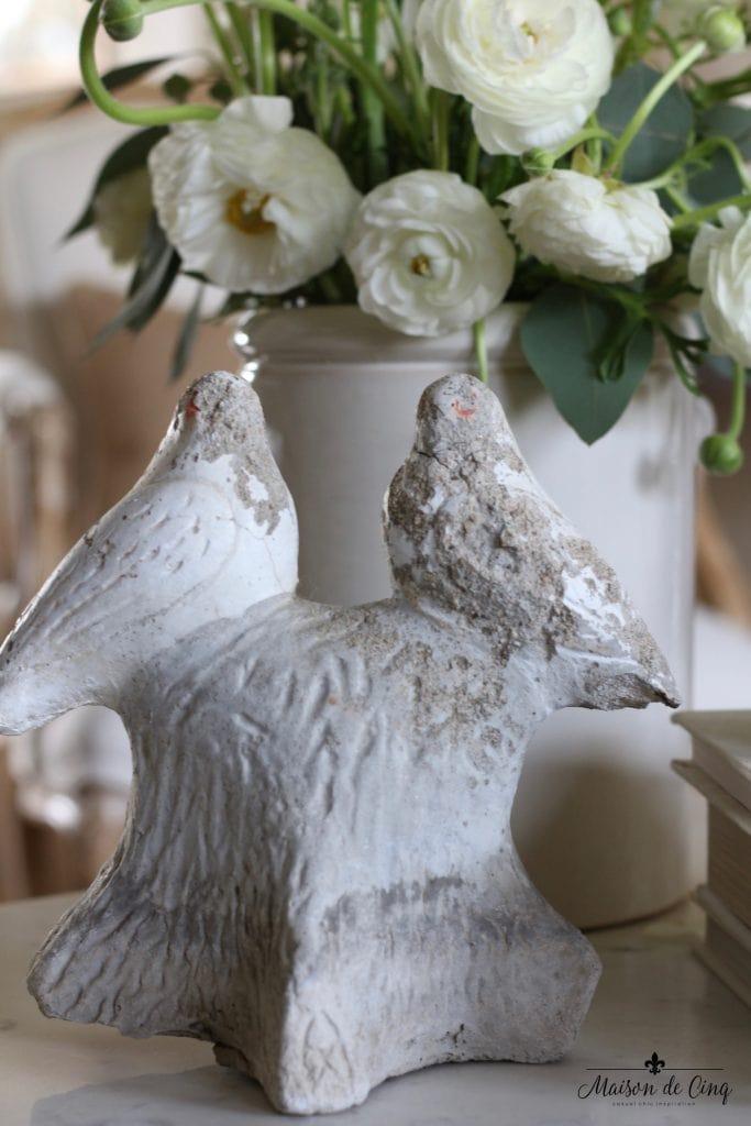 spring decorating ideas white flowers ranunculas statue simple elegant decor