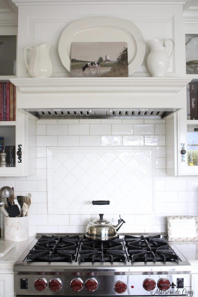 art in the kitchen white farmhouse style kitchen cow picture stove mantel