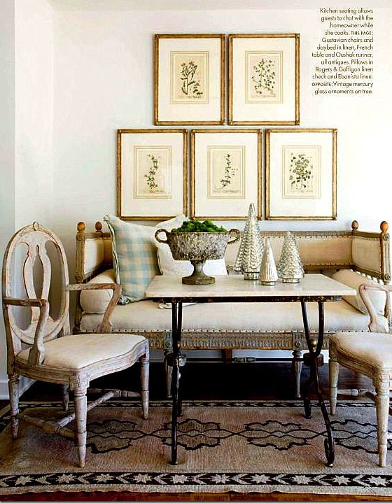 antique botanicals gallery wall over a breakfast room settee dining area french swedish style