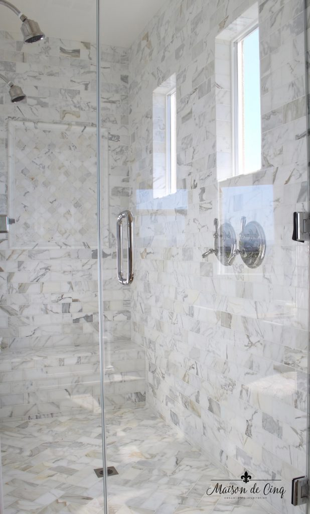 master bathroom remodel marble tile shower dual heads glass door windows