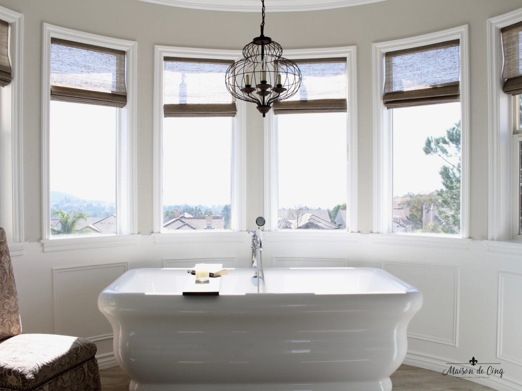 master bathroom remodel circular window area free standing tub chandelier