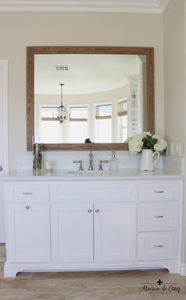 master bathroom remodel white vanity quartz counters barn wood mirror flowers