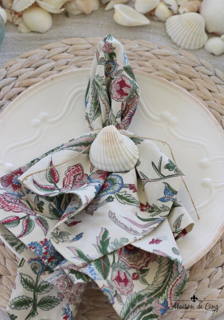 coastal tablescape printed napkin shells willow natural charger summer table