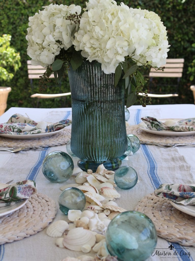 coastal tablescape white hydrangeas blue vase backyard setting perfect summer table coastal beach elements