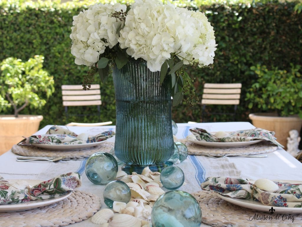 coastal tablescape backyard perfect summer table texture watery blues white flowers shells