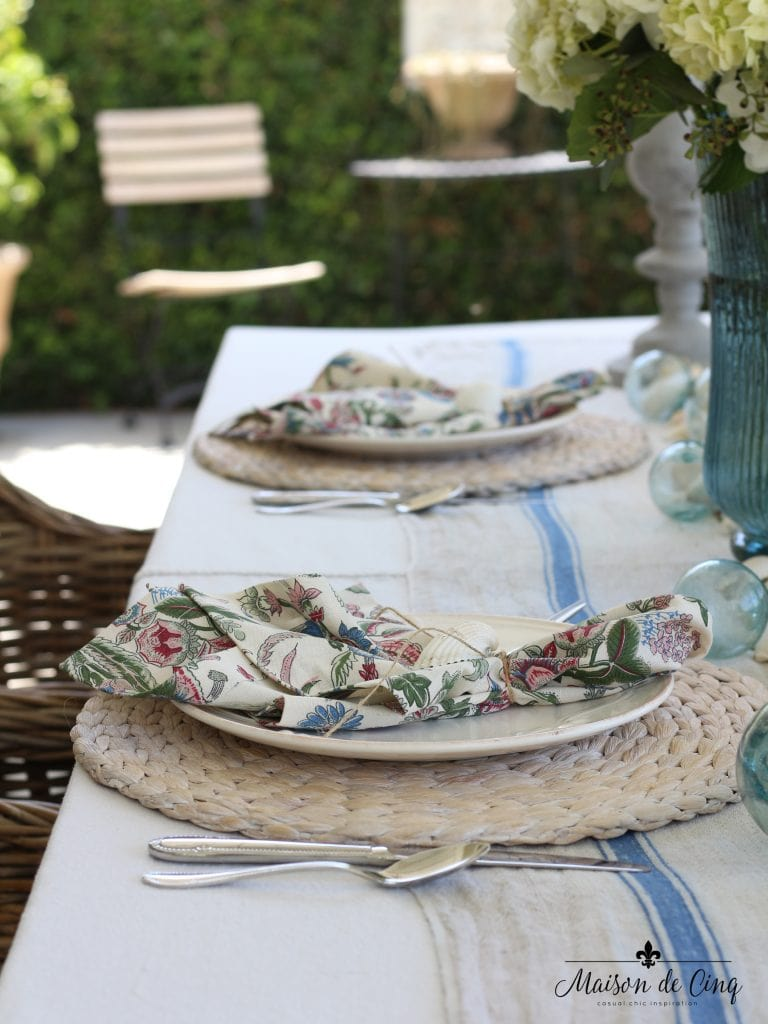 coastal tablescape printed napkins willow chargers backyard setting perfect summer table