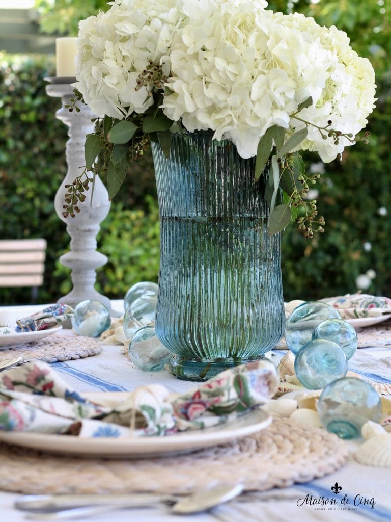 coastal tablescape blue vase white flowers backyard summer table setting beach inspired