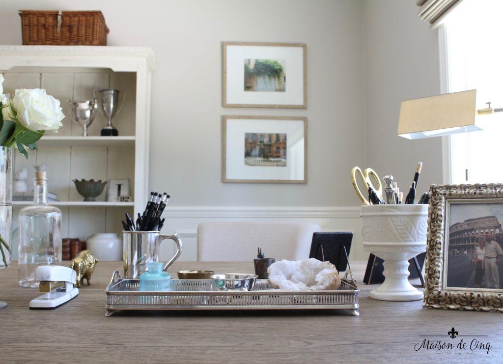 home office makeover desk lamp artwork wall gallery bookshelves neutral color french inspired