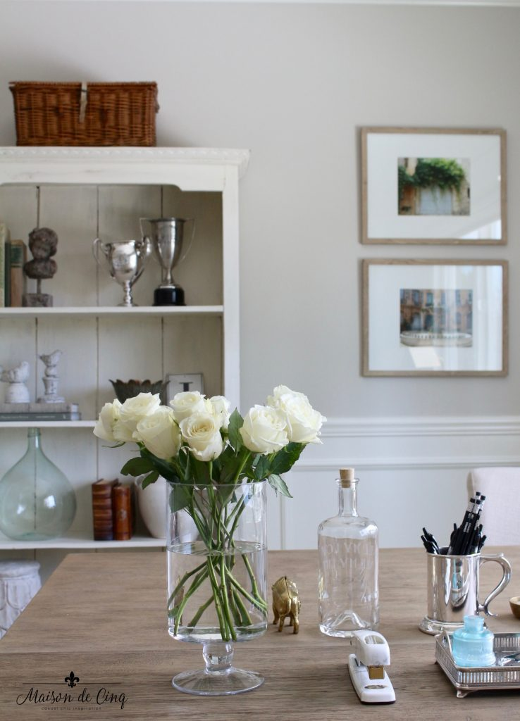 home office makeover french inspired gorgeous soft neutral color room artwork shelves bookcase flowers on desk