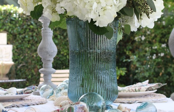 Coastal Inspired Table with Watery Blues, Shells, and Natural Elements