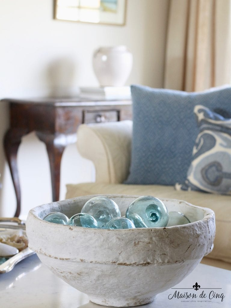french country summer home tour blue and white living room summer decor blue fishing floats in white bowl