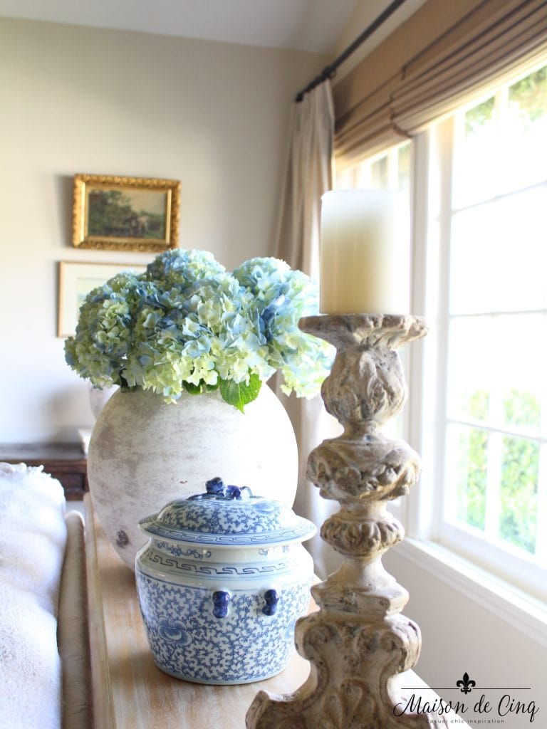 blue and white ginger jars hydrangeas in pot candleholders on console table french country living room