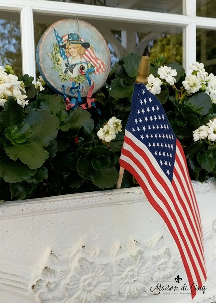 patriotic tablescape flag and decor in white flower planter