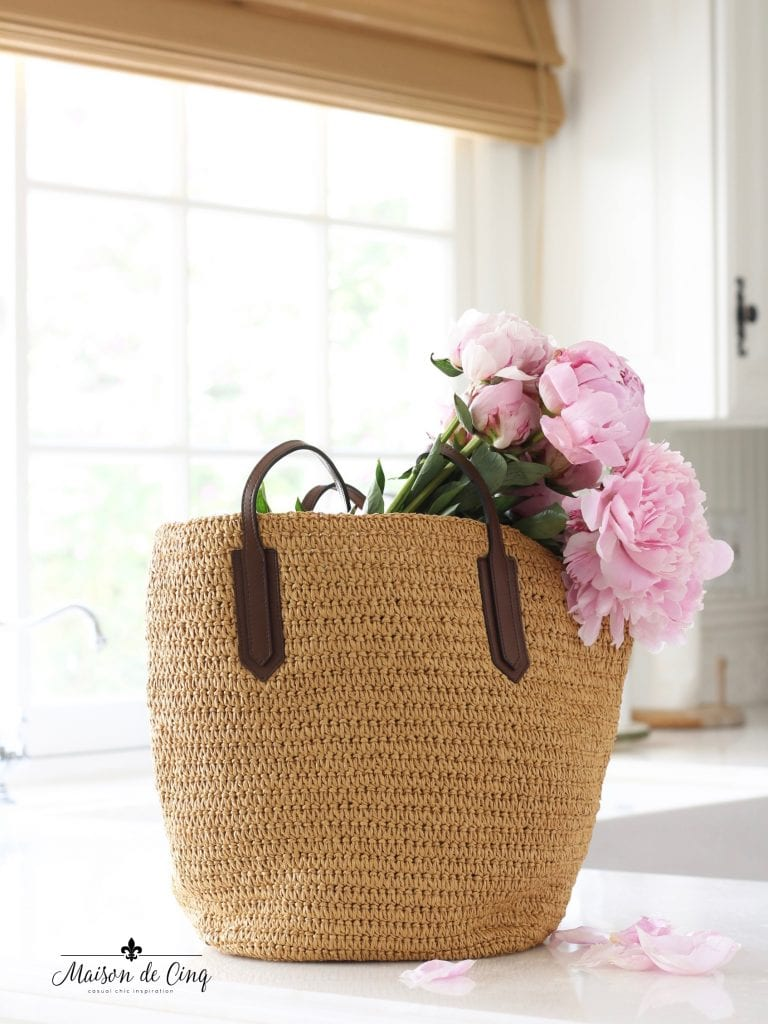 summer essentials straw bag j crew holding peonies summer style